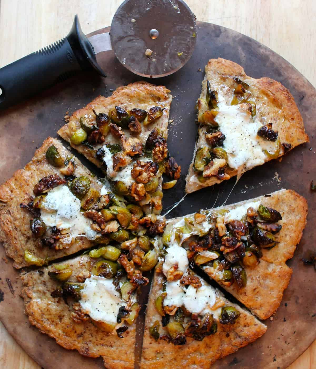 Brussels Sprouts on pizza? Oh yeahhhh. Brussels sprout and walnut pizza with creamy burratta and a whole-wheat flax crust. | @TheFoodieDietitian