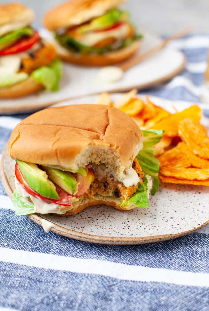 buffalo chickpea burger with lettuce, tomato, and avocado