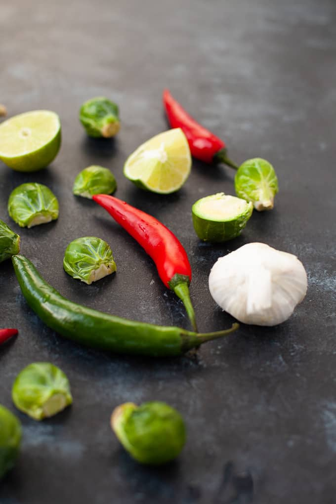 brussels sprouts, chili peppers, onions and limes