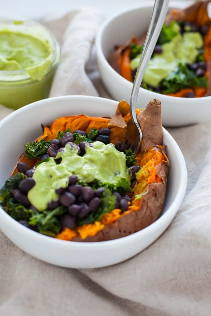 Loaded Sweet Potato with kale, beans and vegan green goddess dressing
