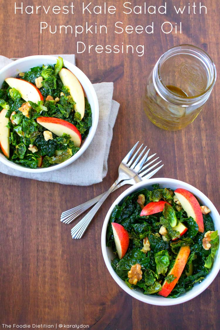A harvest kale salad packed with seasonal ingredients and topped off with a pumpkin seed oil dressing. Perfect for a weekday lunch or as a special appetizer for your Thanksgiving menu. | The Foodie Dietitian @karalydon