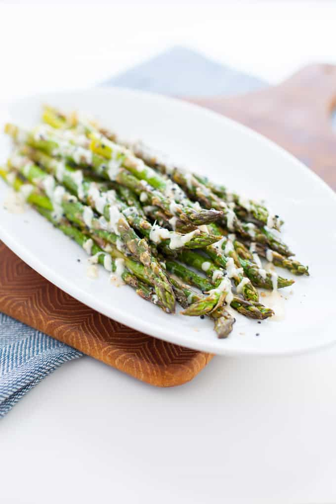 Roasted Asparagus with Miso Ginger Kefir Dressing found in Nourish Your Namaste e-book