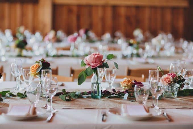 rustic barn wedding flowers table setting