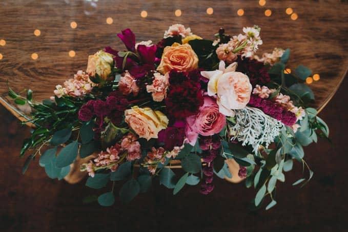 rustic barn wedding flowers sweetheart table