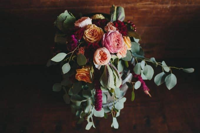flowers barn wedding wine barrels