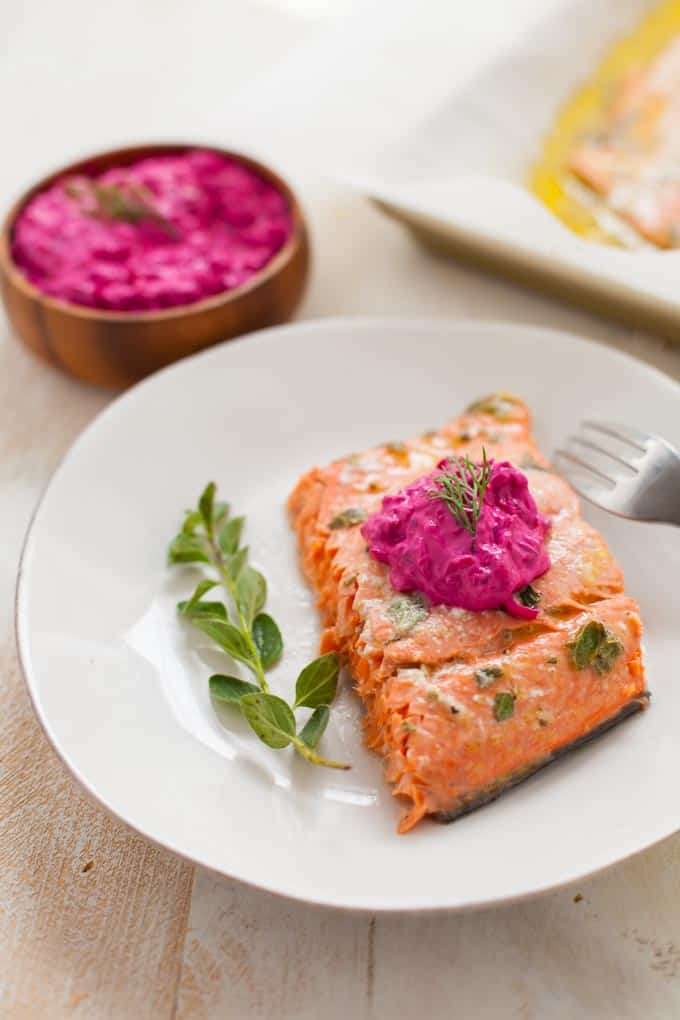 October is National Seafood Month! Celebrate the delicious and nutritious benefits of eating seafood, starting with my Greek-marinated salmon topped with beet tzatziki.