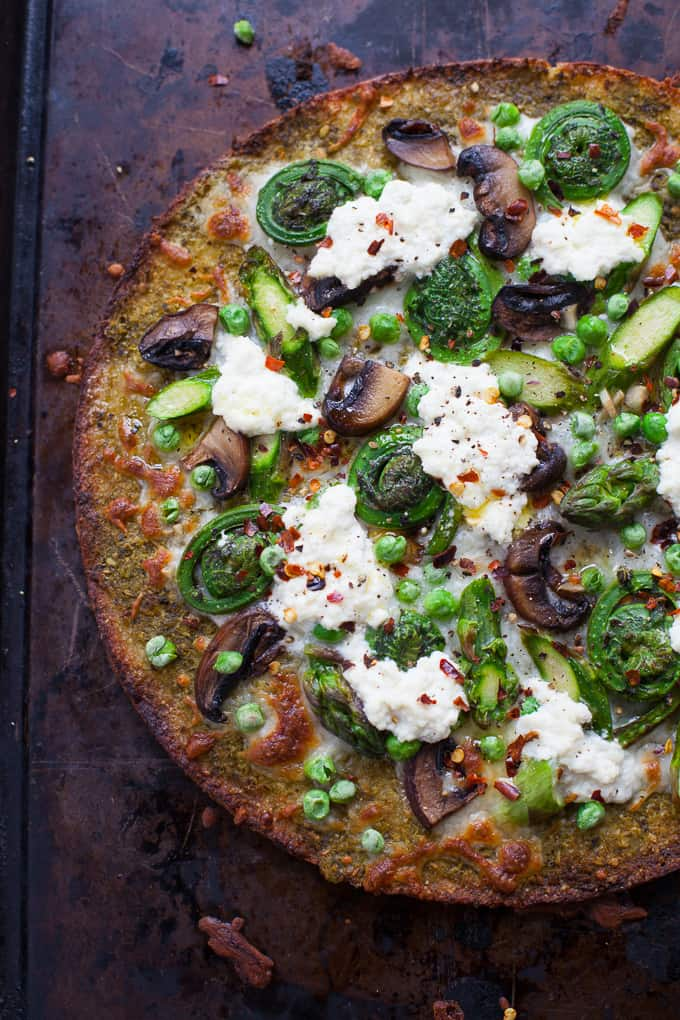 A delicious seasonal veggie-packed pizza made with Trader Joe's Cauliflower Pizza Crust, this Farmer's Market Spring Vegetable Pizza is one you'll want to add to your Friday night pizza party rotation.