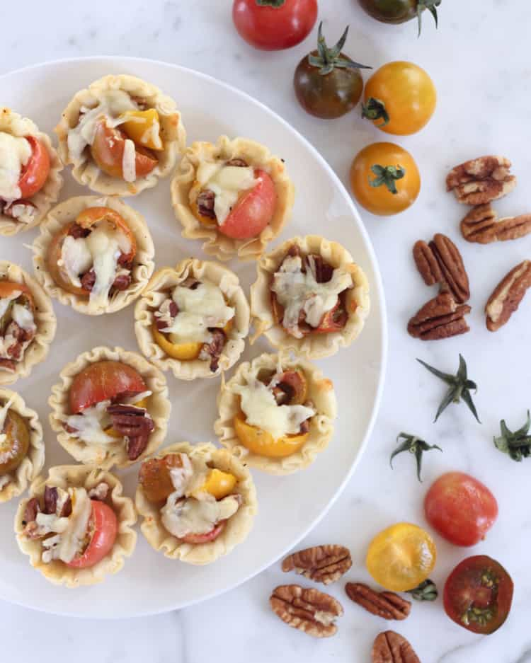 A quick and easy, 7-ingredient appetizer, these tomato pie bites are the perfect hors d'oeuvres for your next summer party!