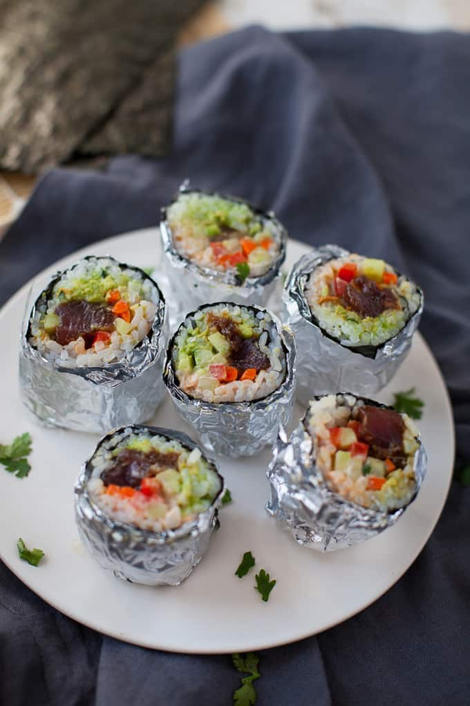 These mini tuna sushi burritos are the cutest appetizers to serve at your next get-together! Not to mention, they're pretty delicious too.