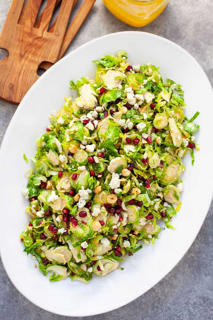 shaved brussels sprout salad with pomegranate seeds and citrus dressing #holiday #salad