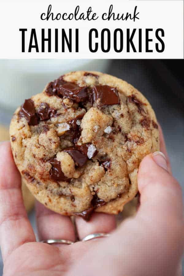 Crispy on the outside, chewy on the inside and oh-so-chocolatey. These chocolate chunk tahini cookies are everything you'd want in a cookie PLUS the nutty flavor of tahini. #cookies #tahini