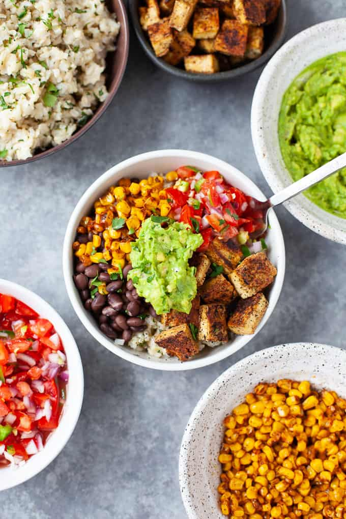 A Chipotle inspired vegan burrito bowl that's bursting with spices and flavor and is more delicious (and easier on the wallet!) than take-out! #chipotle #vegan