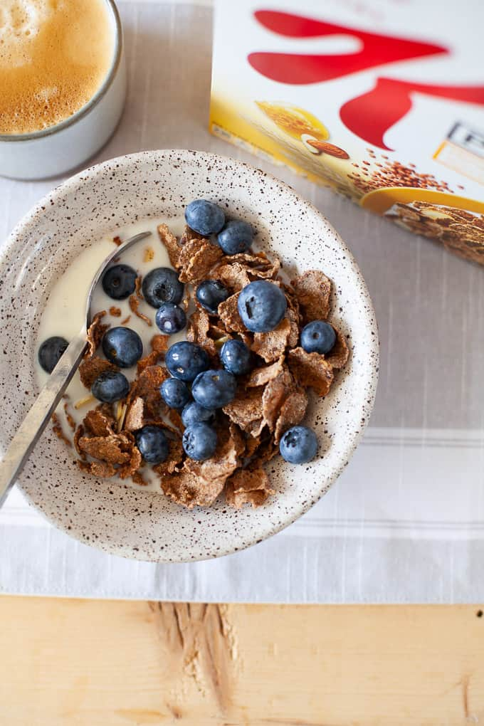 Bowl of cereal with fresh blueberries