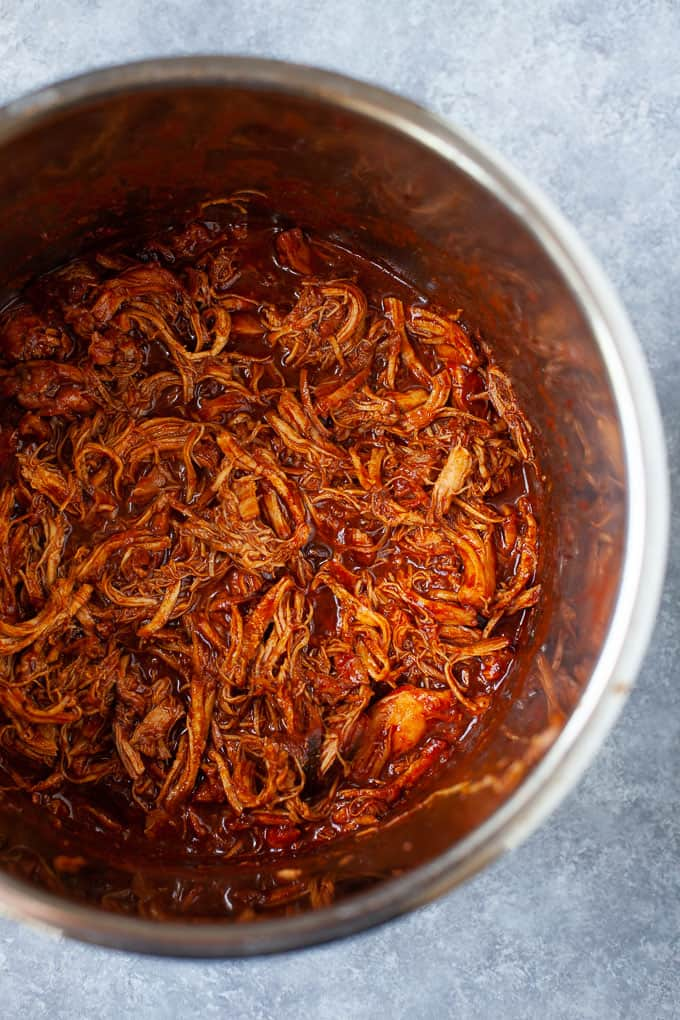 shredded BBQ chicken placed in an Instant Pot