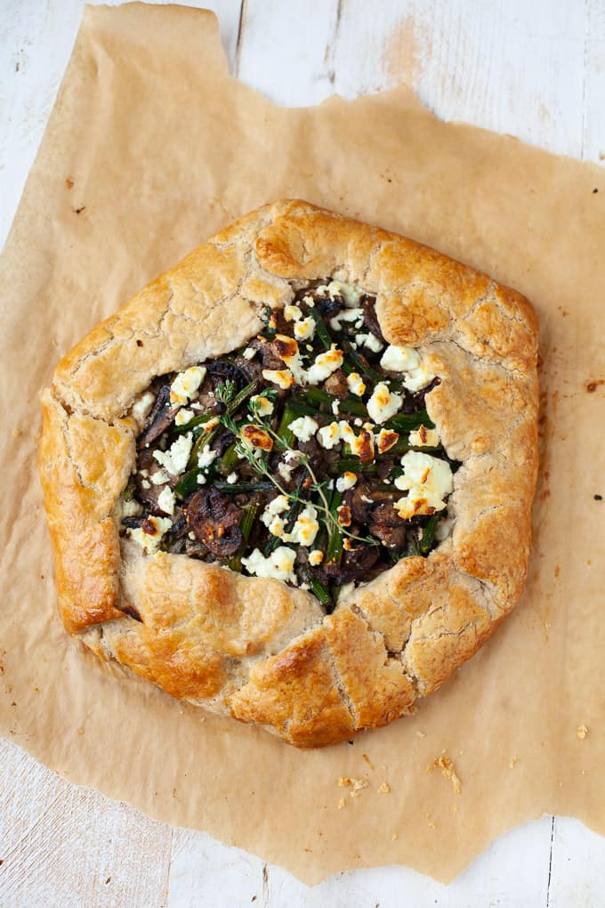 Freshly baked galette with mushrooms, asparagus, and goat cheese