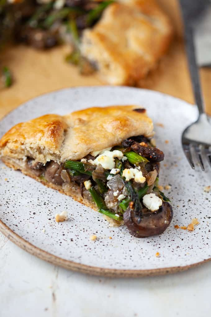 A slice of asparagus and mushroom galette