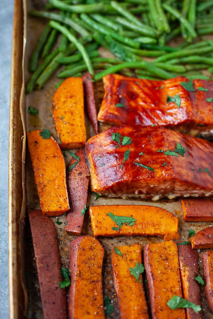 BBQ salmon with sweet potato and green beans on a sheet pan