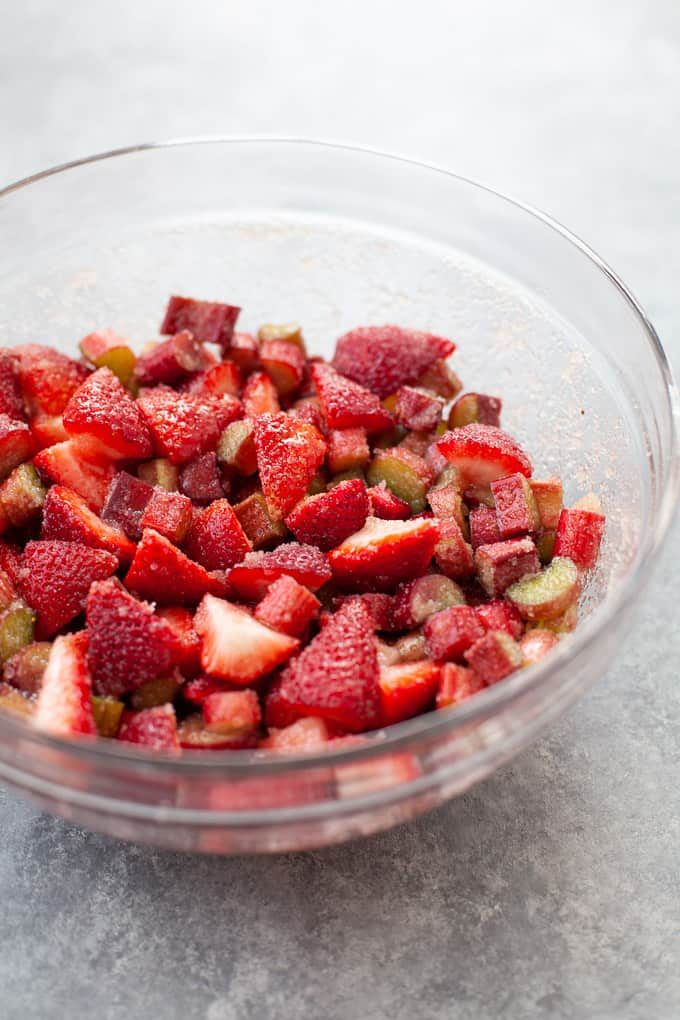 strawberries and rhubarb mixed together in glass bowl