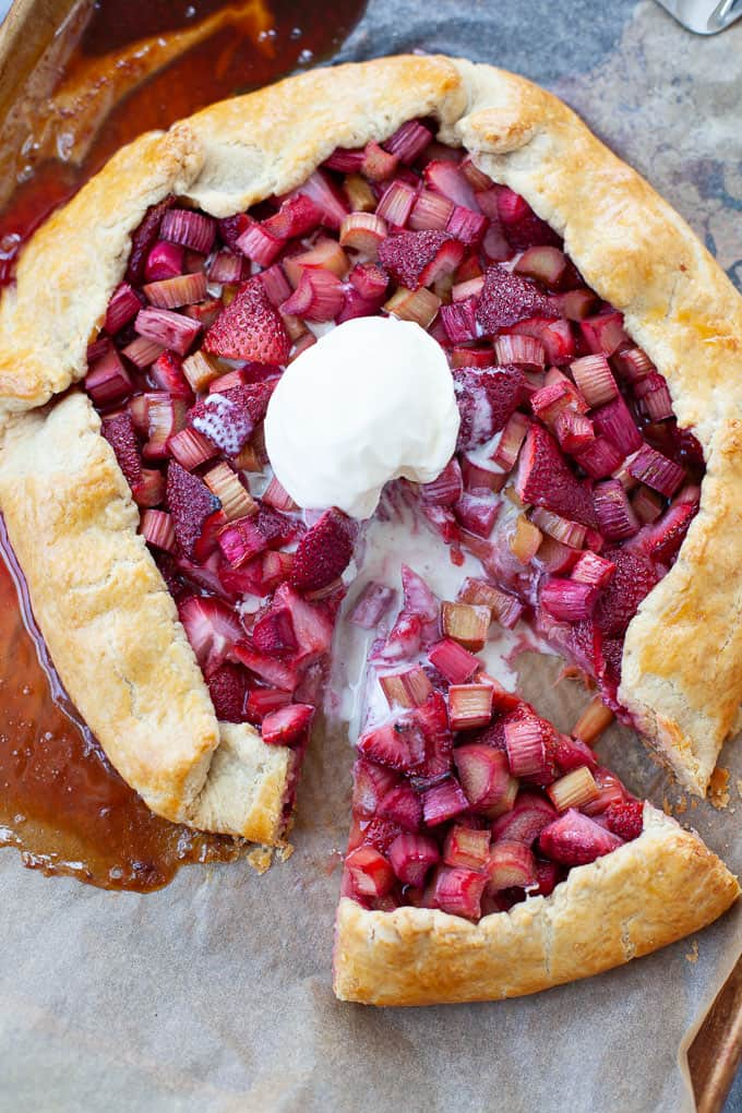 strawberry rhubarb galette with a scoop of vanilla ice cream
