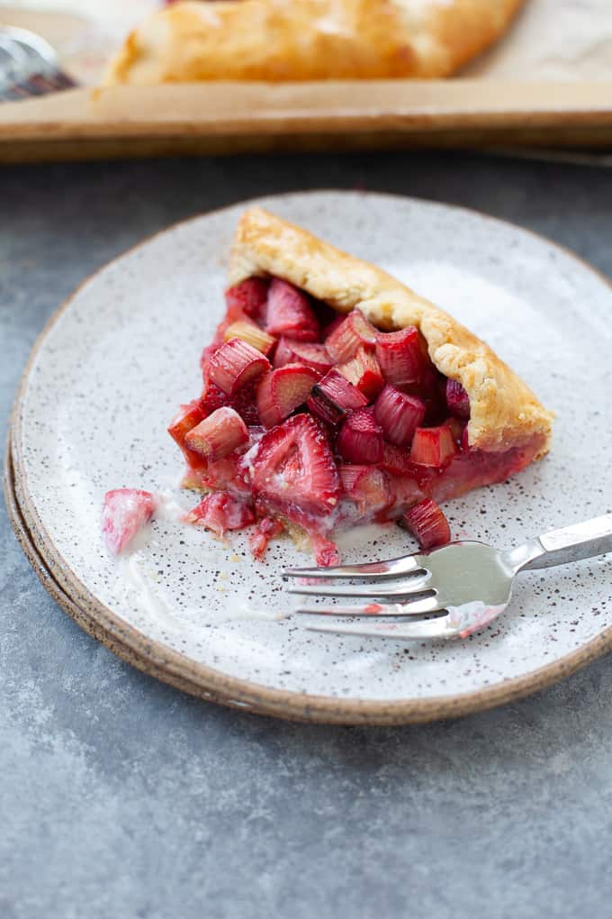 Slice of strawberry rhubarb galette