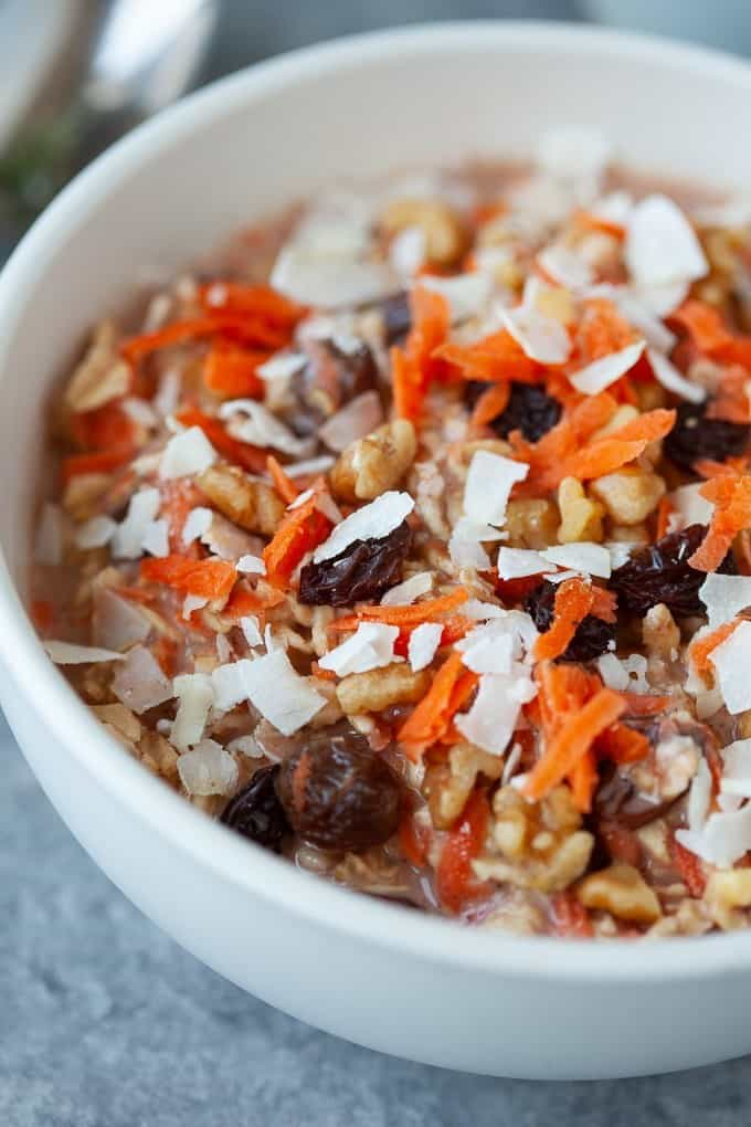 carrot cake overnight oats with shredded carrots, raisins, and coconut shreds on top