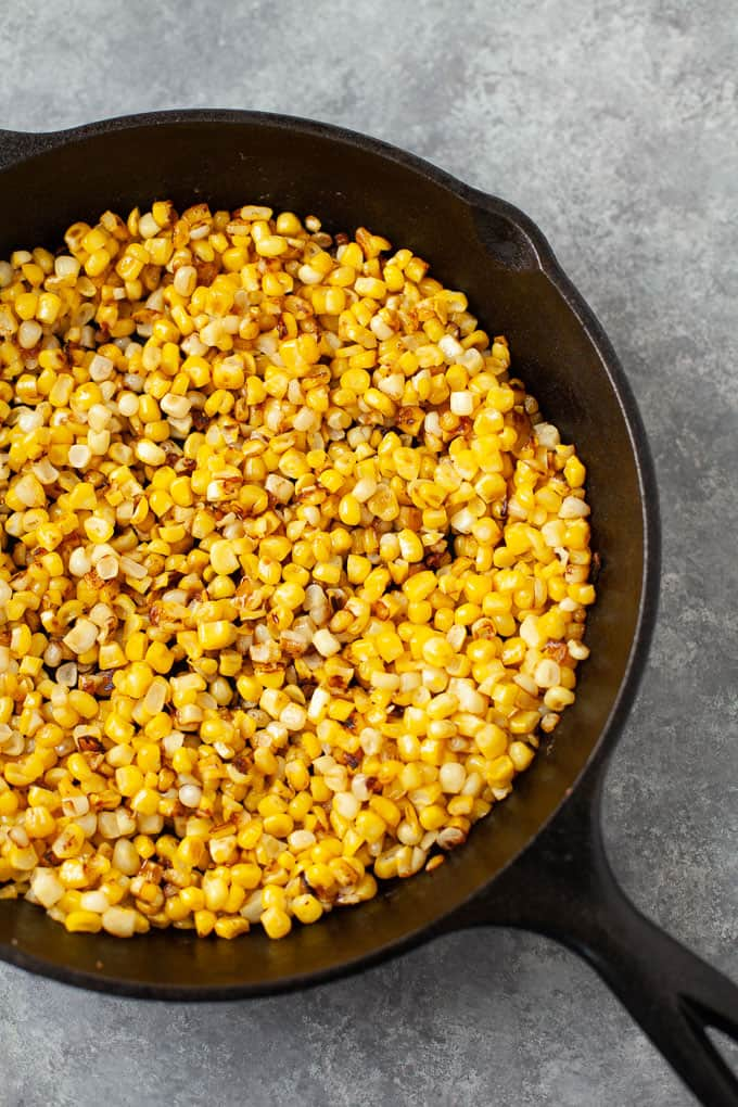crunchy, charred street corn in a skillet