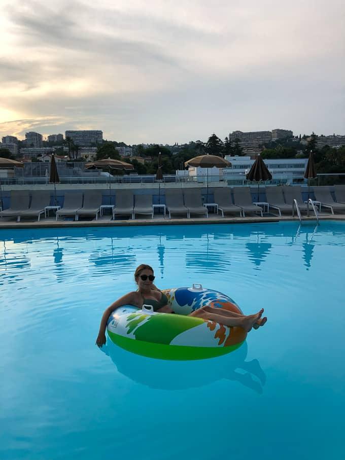 Kara lounging in the hotel swimming pool