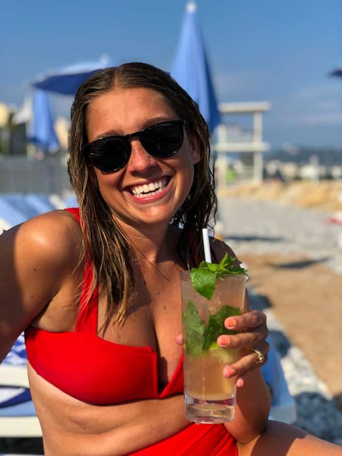 Kara sipping on a mojito at the beach