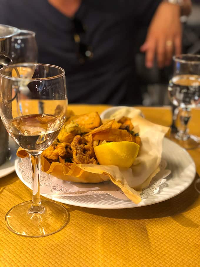 calamari with a glass of wine