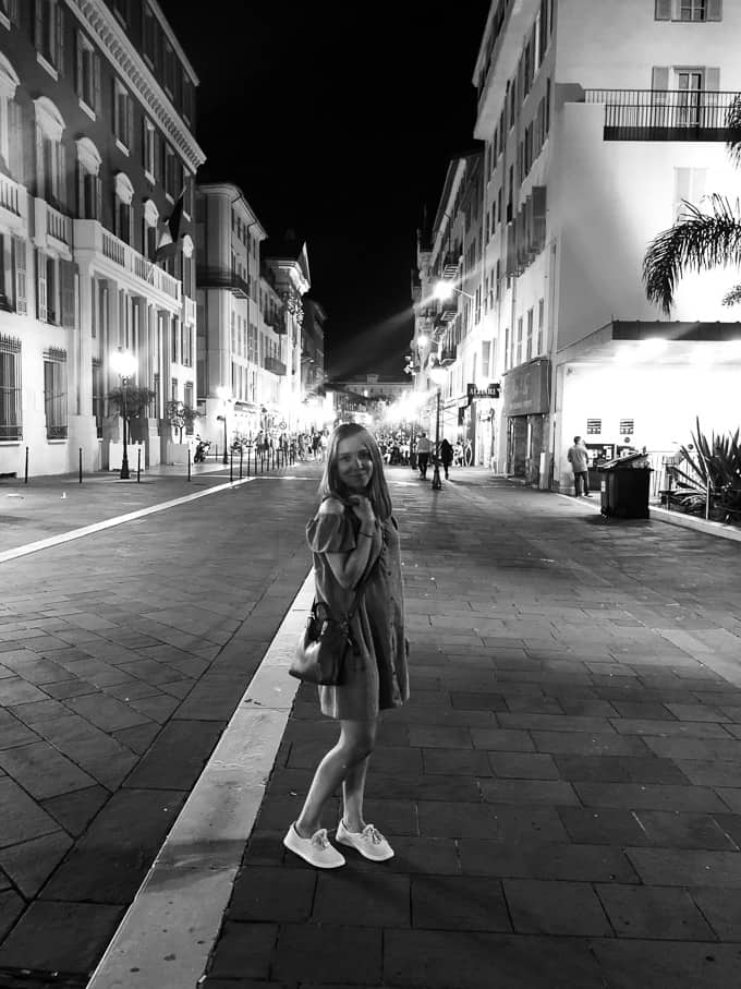Kara standing in the streets of Nice, France