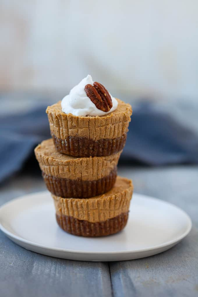 three stacked pumpkin cheesecake cups