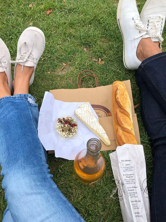 cheese, bread, and a bottle of wine