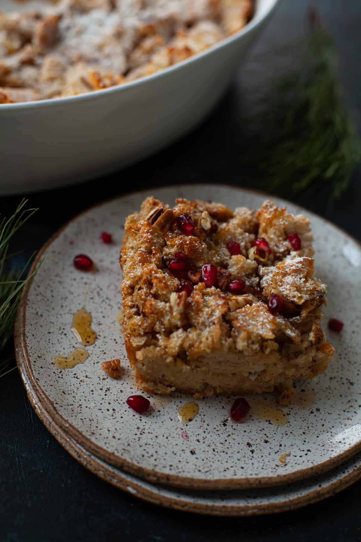 eggnog french toast casserole served with pomegranates and maple syrup