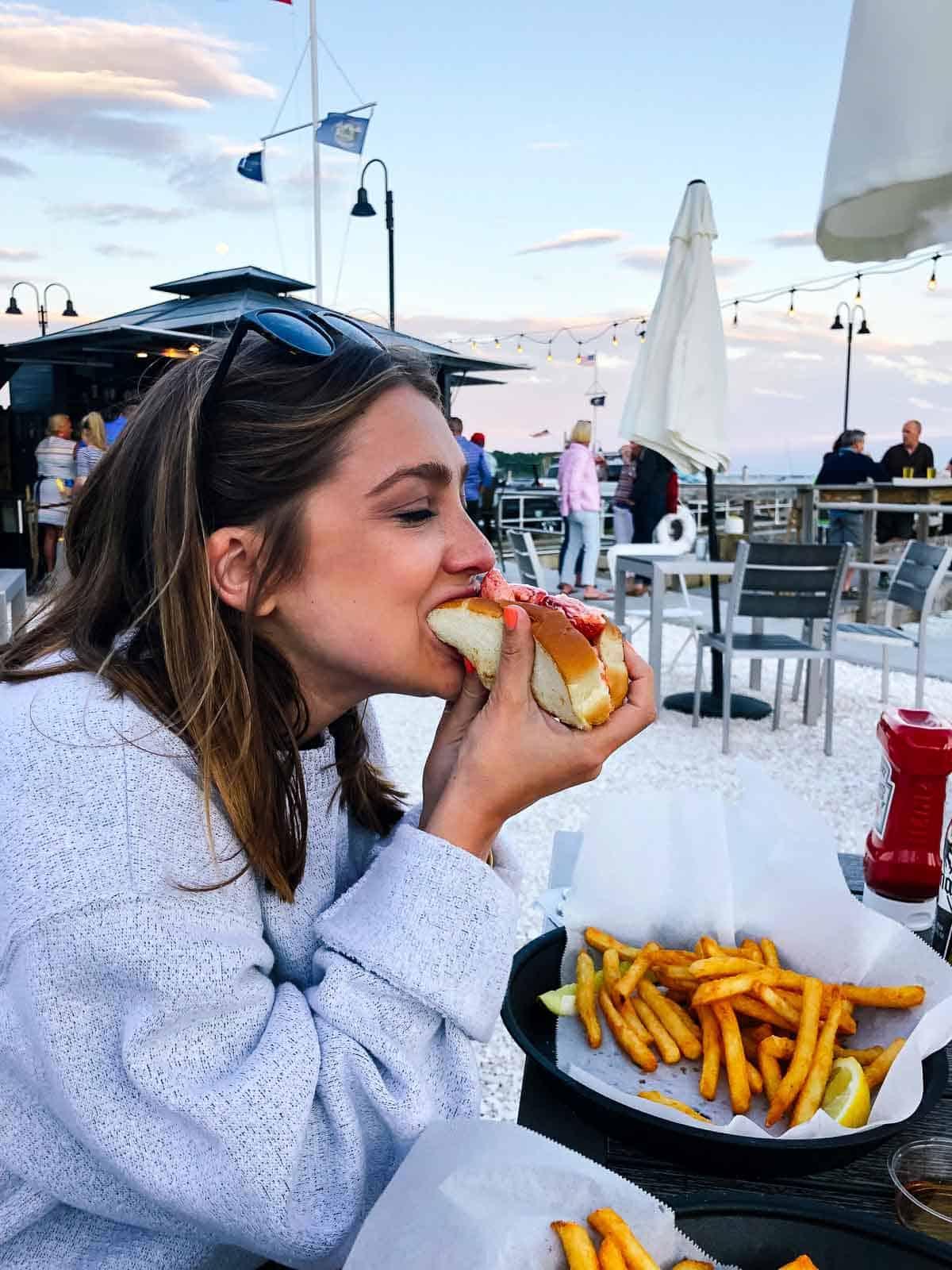 Kara eating a Lobster Roll Sandwich