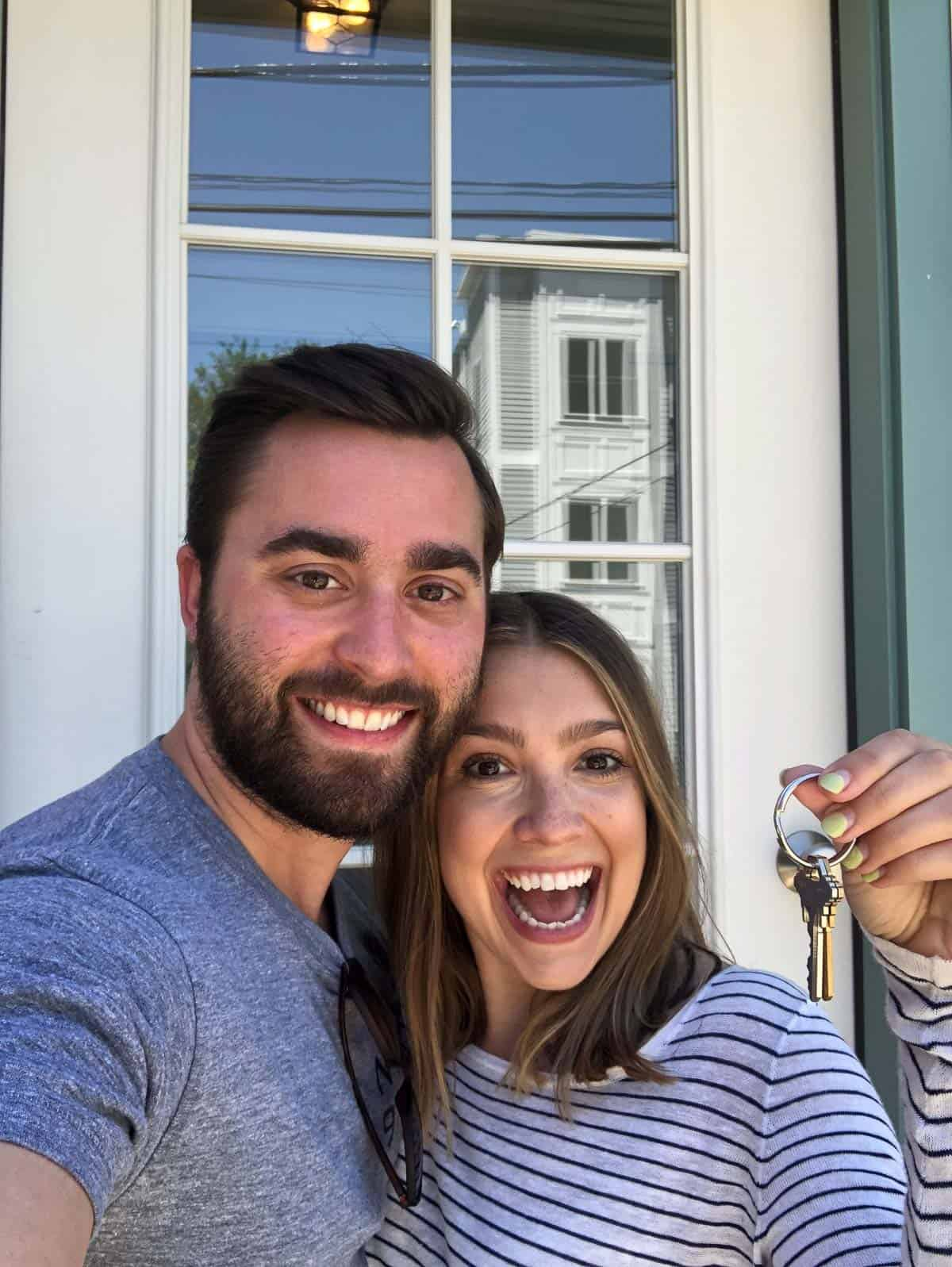 Kara and Steve holding the keys to their new home