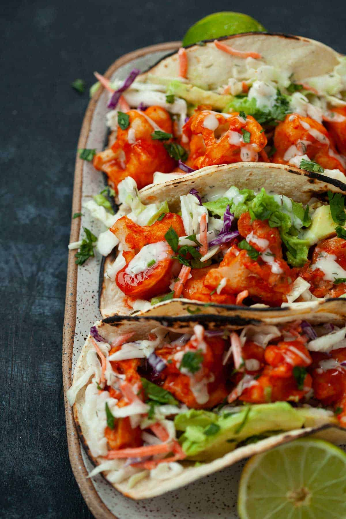three buffalo cauliflower tacos with ranch slaw