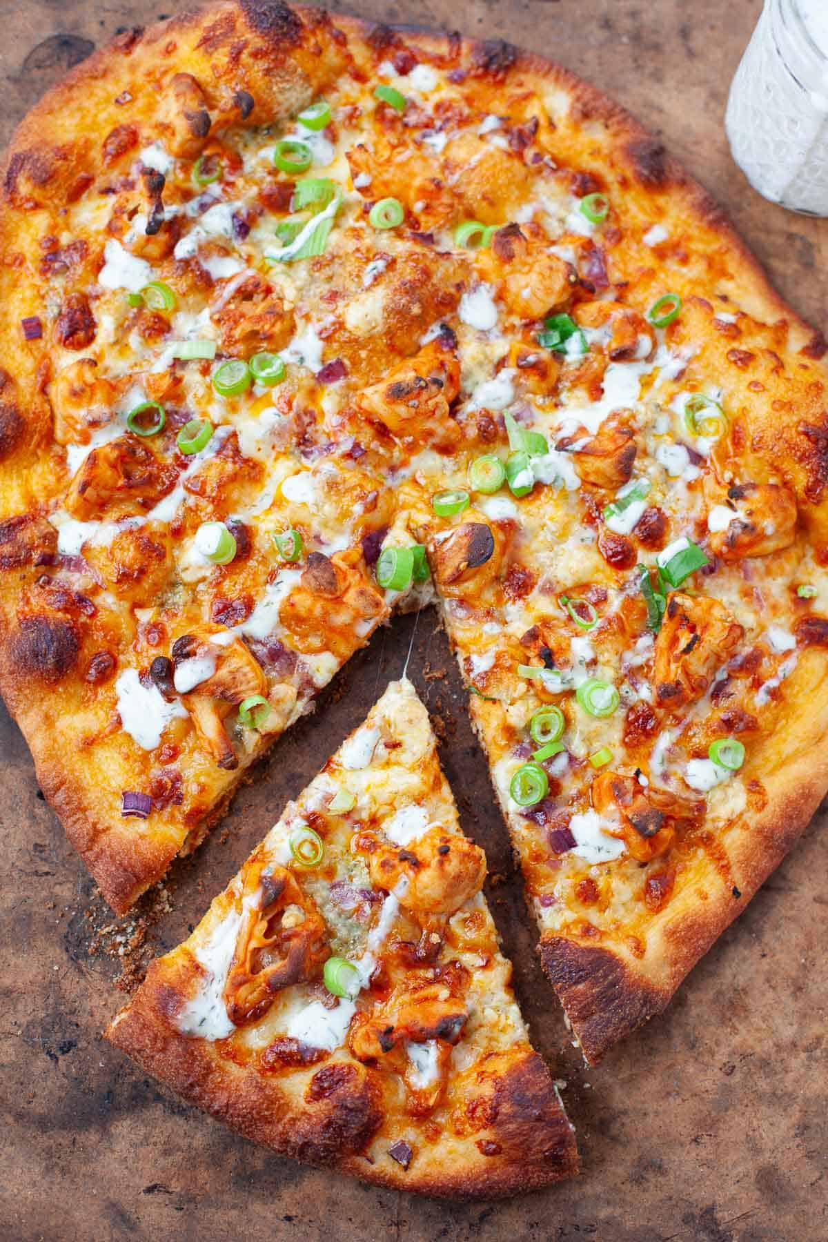 Slice of buffalo cauliflower pizza