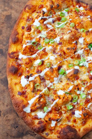 Buffalo cauliflower pizza served fresh out of the oven