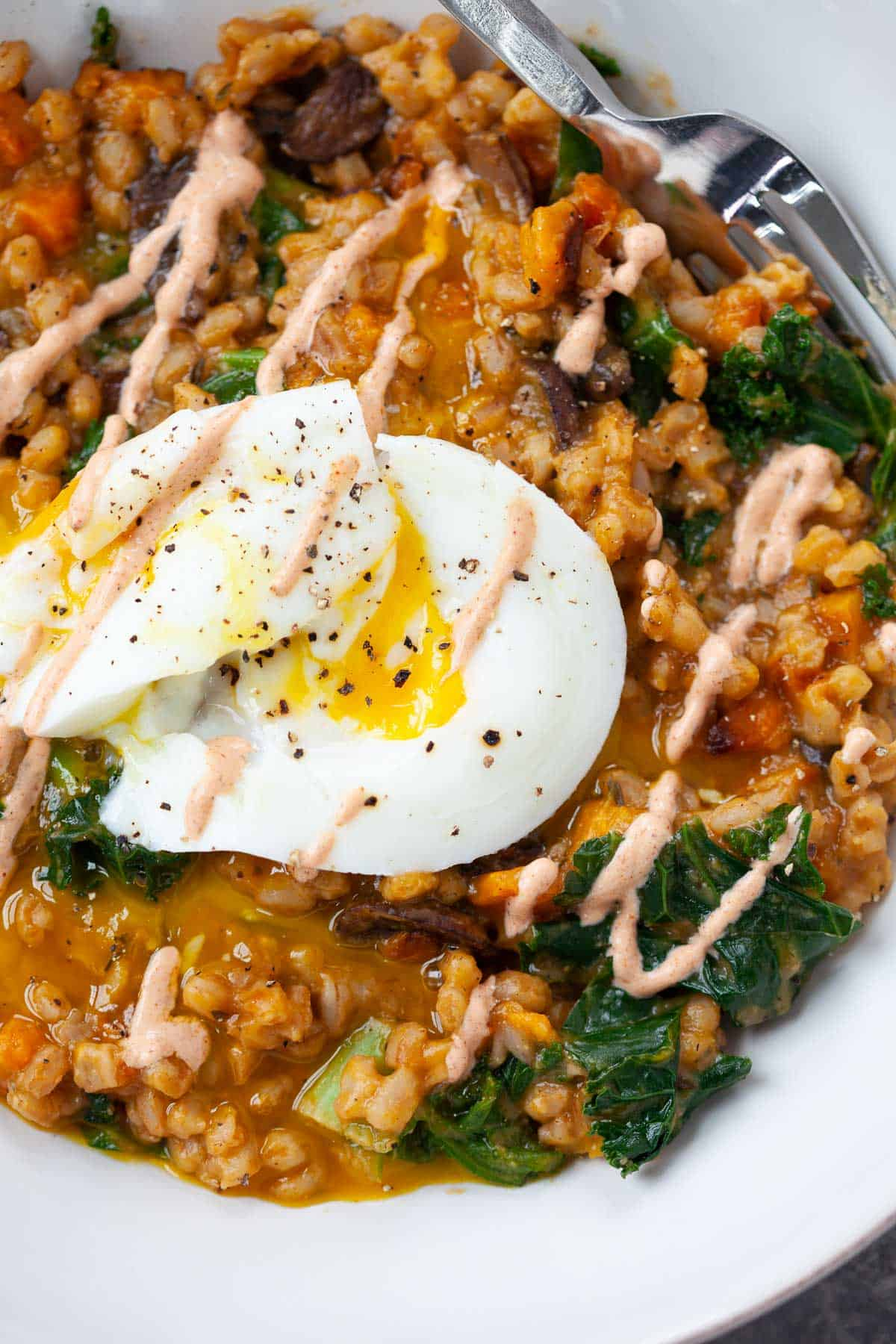 vegetarian farro breakfast bowl with poached egg