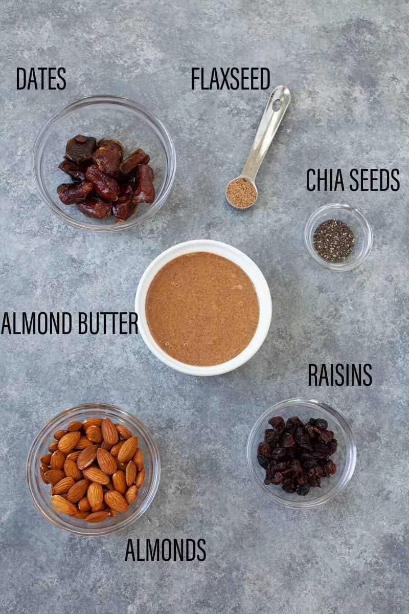 almonds, raisins, almond butter, chia seeds, flaxseed, and dates in various bowls