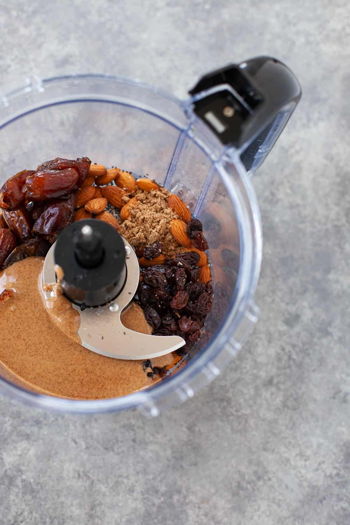 almond butter, raisins, almonds, and dates in a food processor