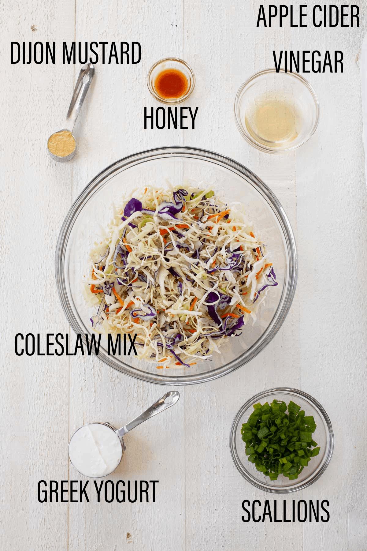 Dijon mustard, honey, apple cider vinegar, coleslaw mix, Greek yogurt, and scallions in separate bowls