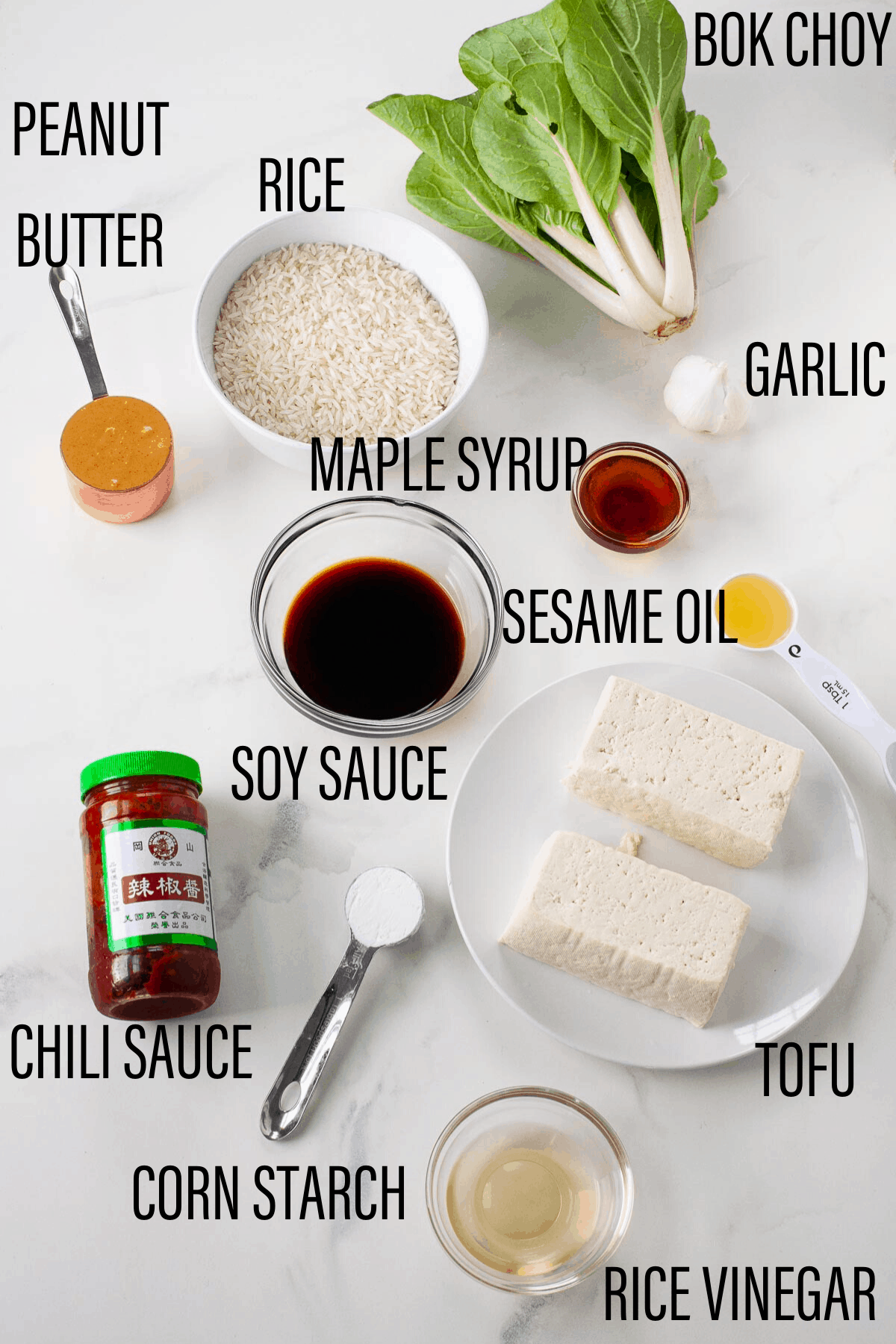 ingredients for tofu rice bowl spread out on a countertop