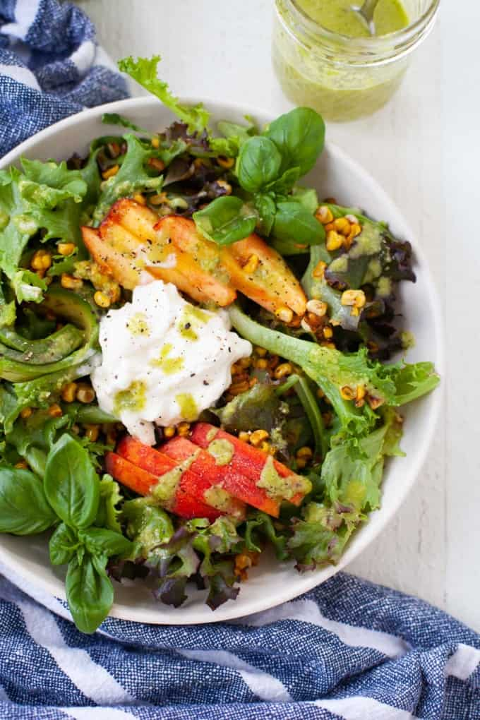 summer peach salad with green, burrata, and creamy green dressing