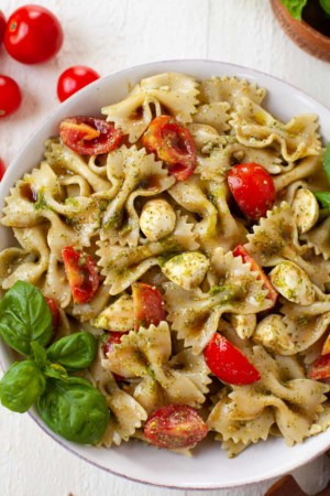 bowl of caprese pasta salad with fresh basil