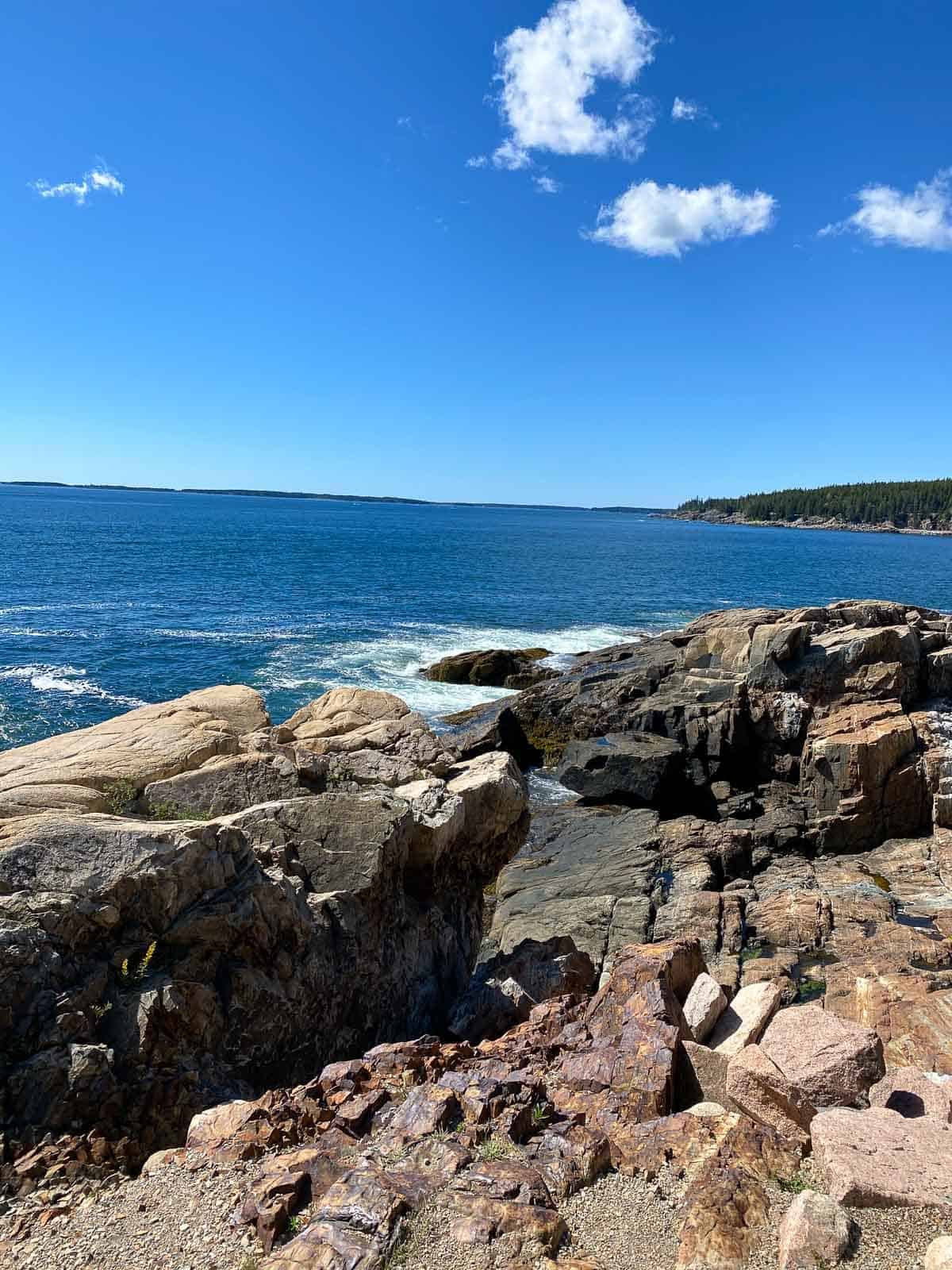 rocks along the edge of the ocean in Bar Harbor, Maine
