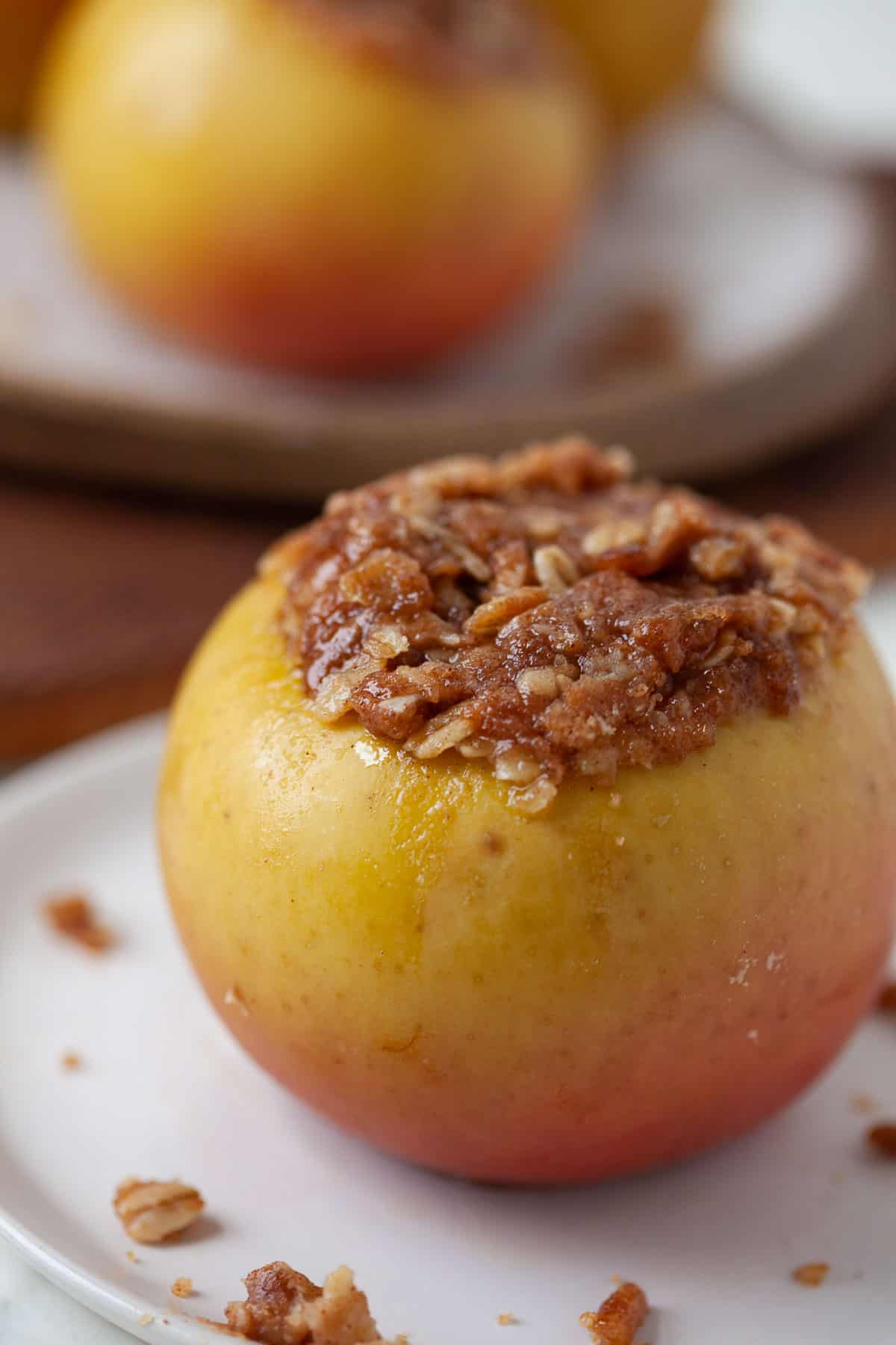 baked apple with oat and cinnamon mixture in the center