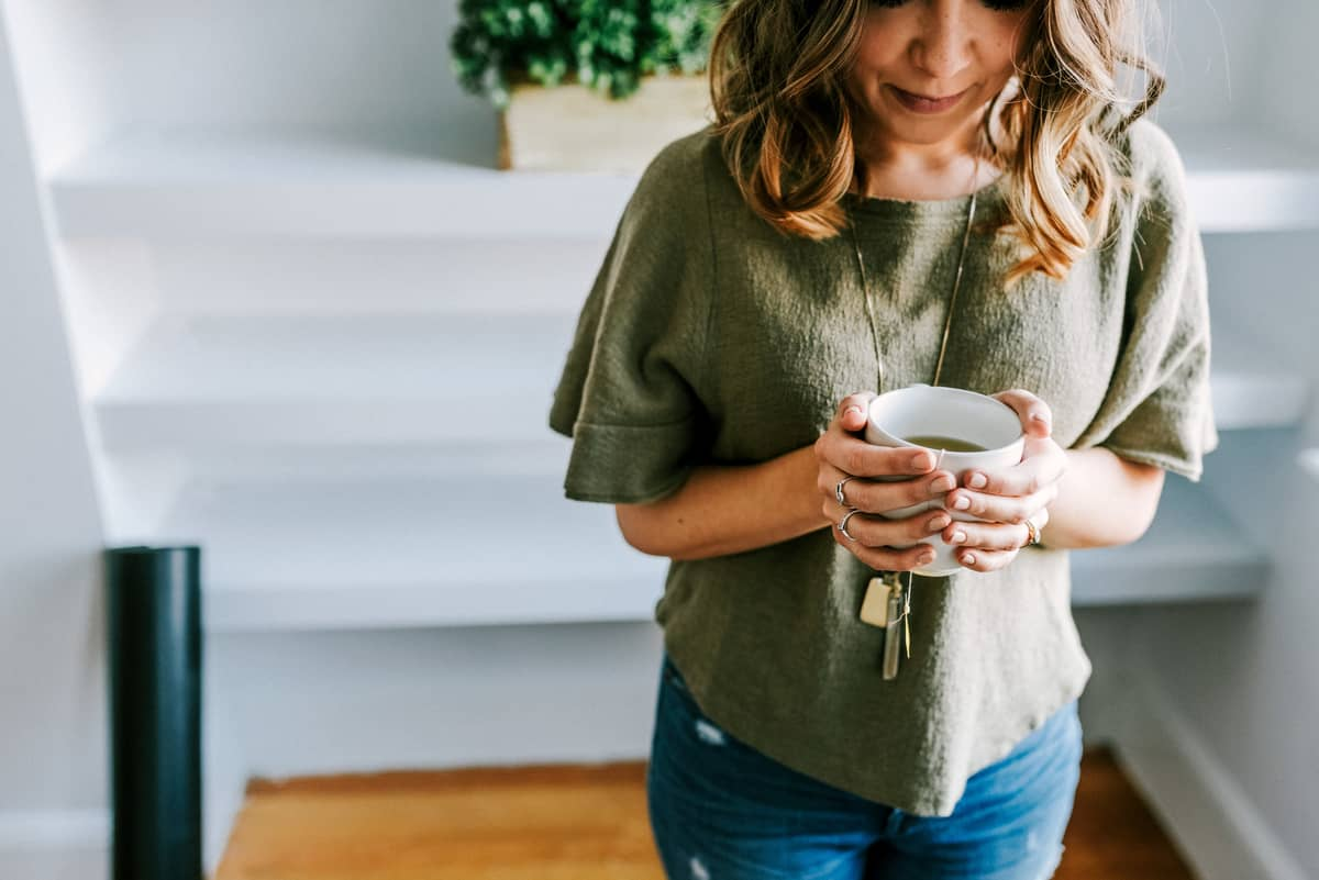 Kara holding a warm cup of tea