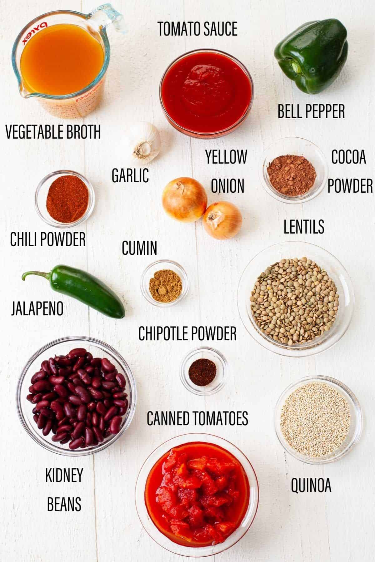 ingredients for instant pot vegetarian chili with text overlay on white surface