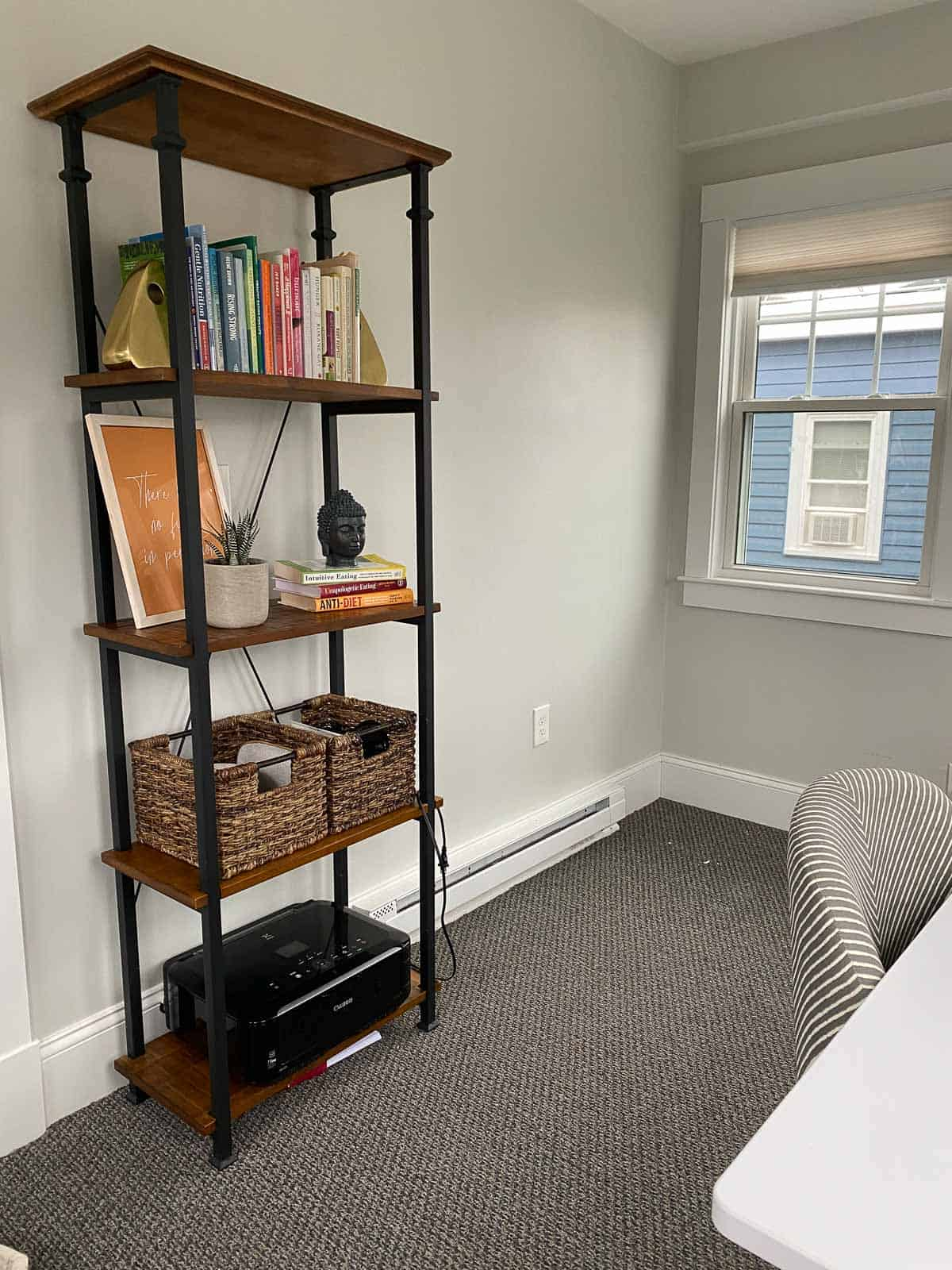 kara lydon second trimester pregnancy reorganize office room nesting project cleaning after photo bookshelf buddha head